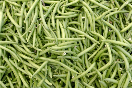 Freshly picked green beans on display at the farmer photo
