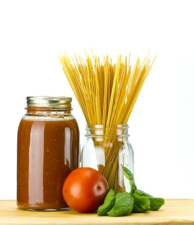 Fresh basil and tomato with homemade tomato sauce and whole wheat spaghetti pasta
