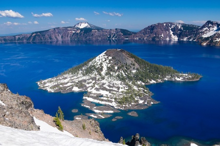 crater lake: View of Wizard Island in Crater Lake with snow cover Stock Photo