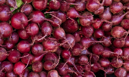 Freshly harvested red beets on display at the farmer