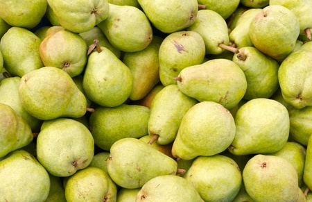 Freshly picked green Bartlett pears on display at the farmers market
