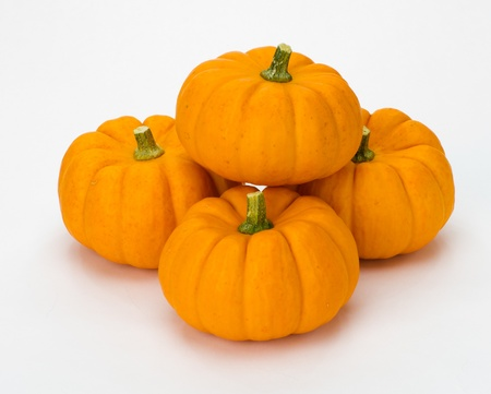 Fall or Autumn or Halloween pumpkins stacked for decoration on white photo