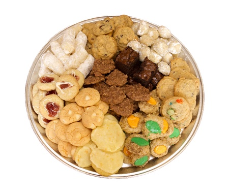 Homemade fresh baked assortment of cookies on tray isolated on white Banco de Imagens