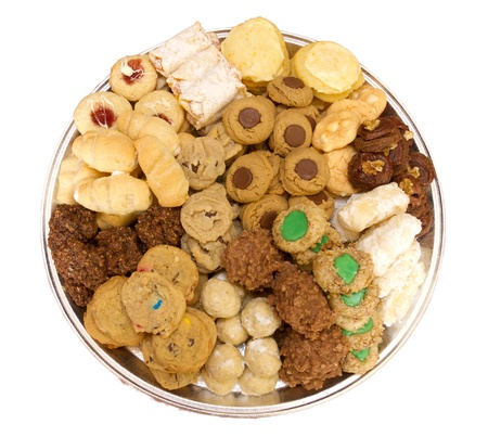 Homemade fresh baked assortment of cookies on tray isolated on white photo