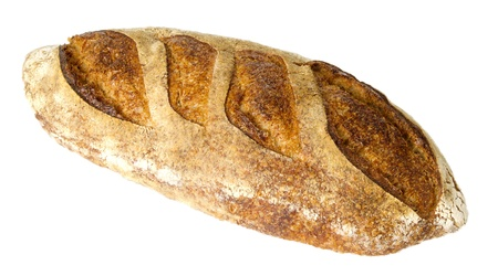 Fresh baked loaf of peasant batard bread isolated on white