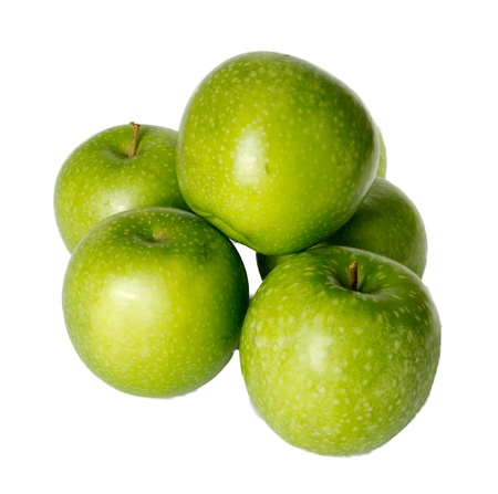 Arrangement of freshly harvested Granny Smith apples isolated on white