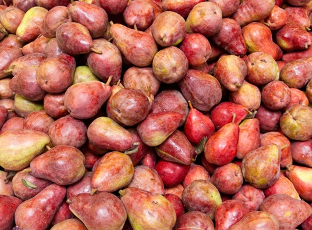 Freshly harvested colorful red bartlett pears on display at the farmers market photo