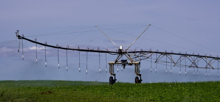 pivot: A large pivot irrigation system supplies water to dry crops Editorial