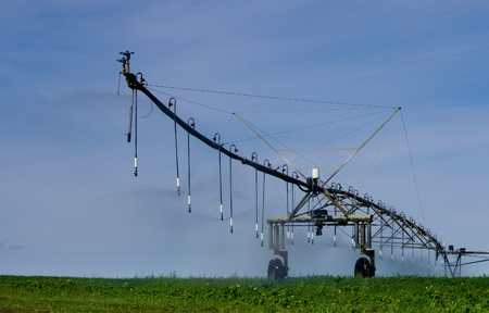 pivot: A large pivot irrigation system supplies water to dry cropland