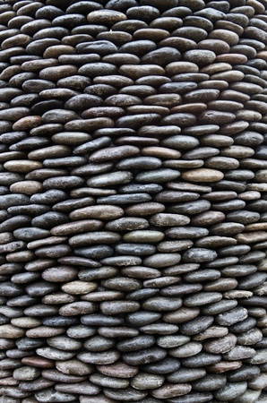 Background of arranged pebbles stones or rocks 스톡 콘텐츠
