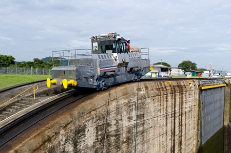 Electric mule engine guides ships through the Miraflores Locks Panama Canal