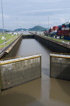 Gates of the Miraflores Locks in Panama Canal opening to allow ships in