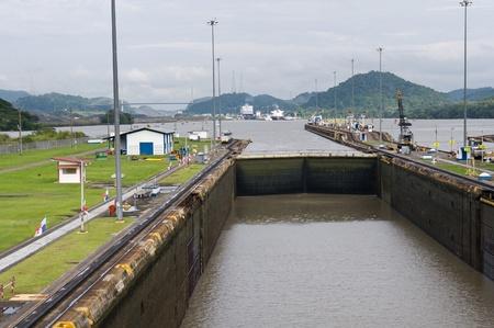 miraflores: Gates and basin of Miraflores Locks Panama Canal filling to raise a ship