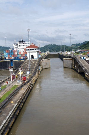 Gates of Pedro Miguel Locks partially open at Panama Canal Stock Photo - 11786461
