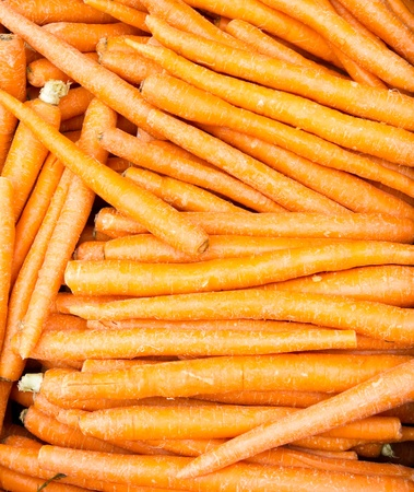 A bulk display of freshly dug carrots ready for sale Imagens