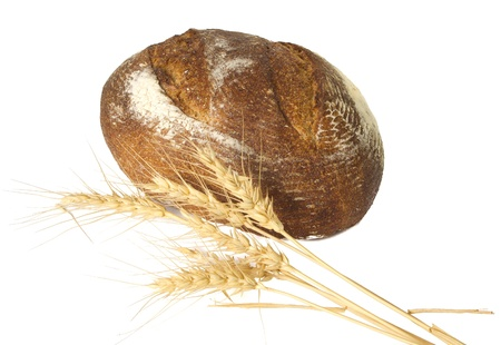 Loaf of fresh baked bread with a sheaf of wheat Stock Photo