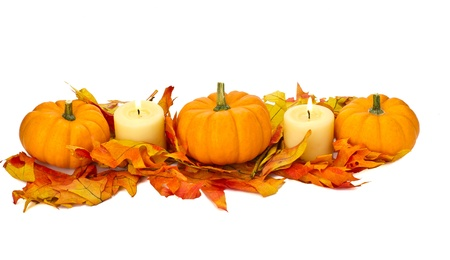 secular: Decorative fall centerpiece with pumpkins leaves and candles