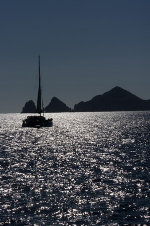 A sail boat heads for port as darkness gathers off the coast of Cabo san Lucas Stock Photo - 11963983