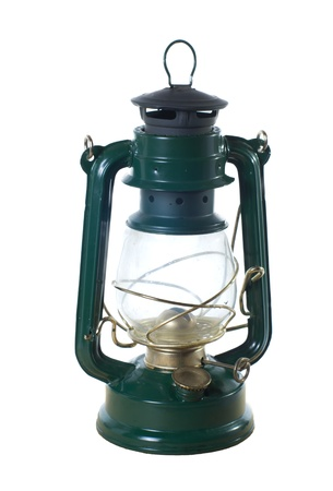 hurricane lamp: A vintage oil lamp or lantern isolated on white