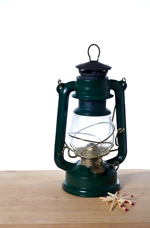 lamp: A vintage oil lamp and matches sitting on kitchen table