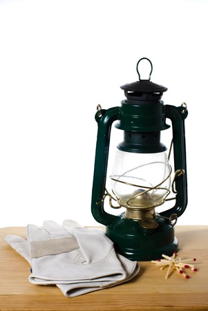 hurricane lamp: Vintage oil lamp sits with gloves and matches