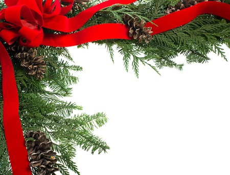 A decorative border with red ribbon bow and pine cones isolated on white Stock Photo - 12305528