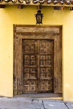 An old wooden door with metal details