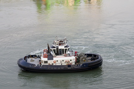A tug boat standing by to assist ships on the Panama Canal photo