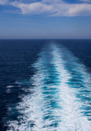 The white wake of a ship contrasts with the blue ocean Stock Photo - 12685561