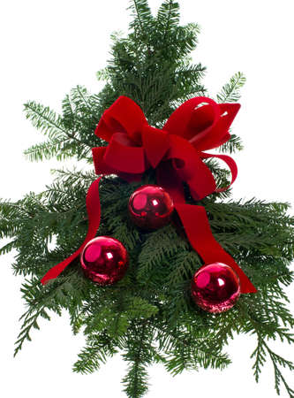 A Christmas decoration with boughs ribbon and ornaments Stock Photo - 12685795