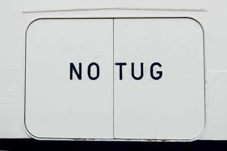 warns: A sign on ships side warns away tugs