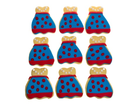 A group of nine decorated apron cookies