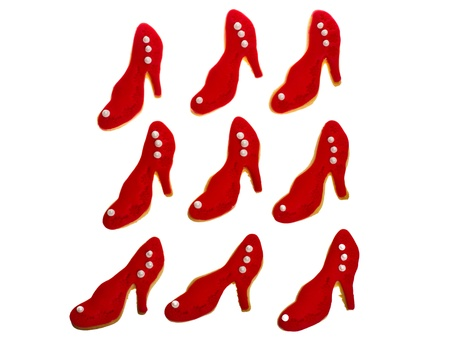 Nine red decorated shoe cookies on white Stock Photo - 13405138