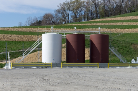 Storage tanks on a gas well drilling site photo