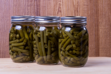 Three jars of homemade preserved beans Stock Photo