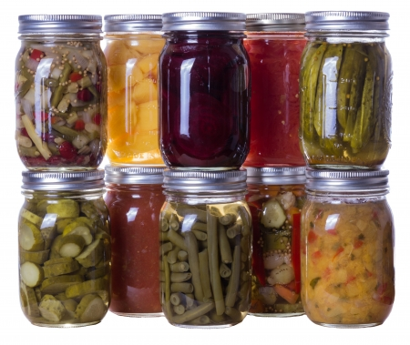 canned: Group of homemade preserves canned goods in mason jars Stock Photo
