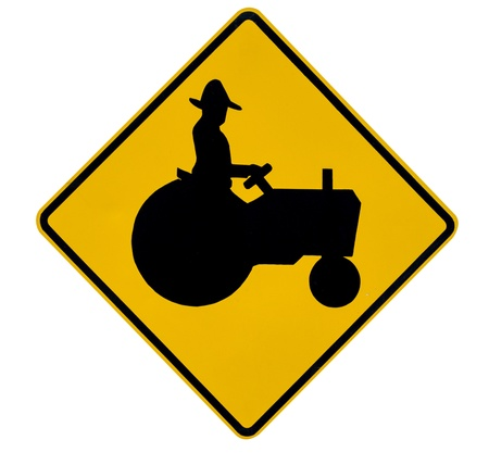 tractor warning sign: A yellow tractor crossing warning traffic sign