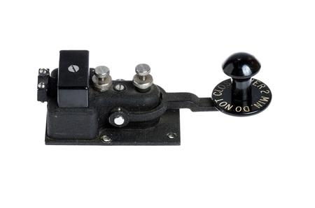 telegraphy: Antique black telegraph key isolated on white
