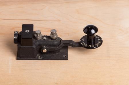telegraphy: A vintage telegraph key sitting on a desk