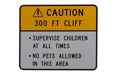 warns: A sign warns of danger hazardous cliff ahead Stock Photo