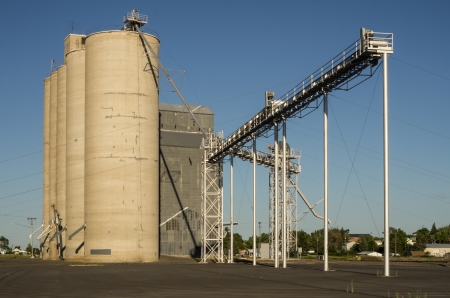 A group of grain elevators or storage silos photo
