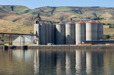A grain elevator storage facility on a river Stock Photo