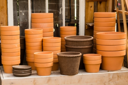 A group of clay planters ready for soil and plants