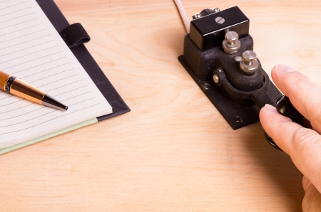 telegram: A telegraph key being operated with notebook Stock Photo
