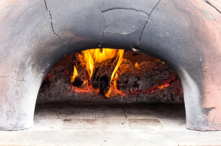 Wood fired oven for bread or pizza with fire photo