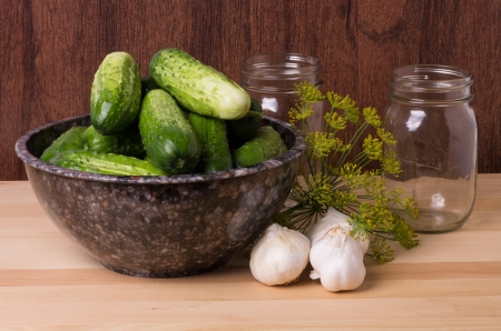 Pickles or cucumbers with garlic and dill ready to be processed photo