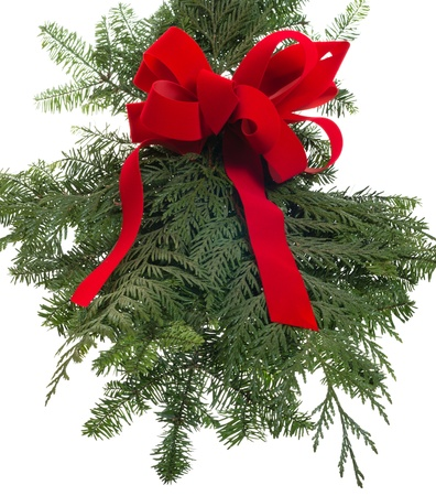 Christmas decoration of live greens with a red bow photo