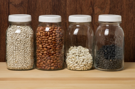 Dry beans stored in glass canisters in the kitchen photo