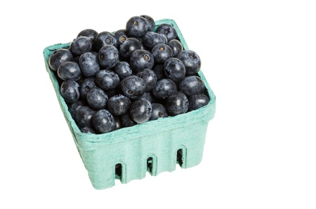 Blueberries in green pint container isolated on white