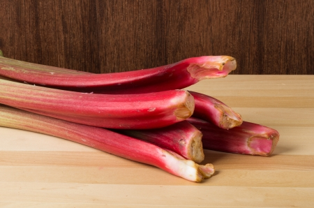 Rhubarb stalks grouped on a wooden table photo